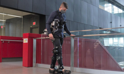 A man wearing a robotic exoskeleton.